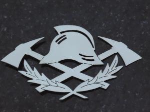 Metalowy znak strażaka